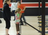 Counselors and campers working together to enjoy bowling.