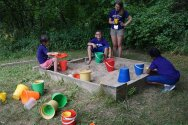 Campers playing in the sandbox