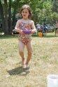 Camper carrying wet sponge for water games