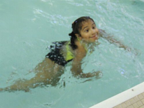 Camper swimming in the pool at the Webster Aquatics Center