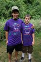 Counselor and camper standing together wearing Camp Smile tshirts