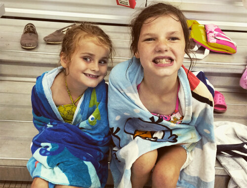 Campers drying off after a fun swim in the pool at the Webster Aquatics Center
