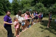 Groups playing water relay game