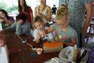 Campers painting containers for a totem pole craft