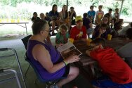 Mother Jane reading a Native American story to our campers