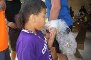 Camper blowing bubble snake