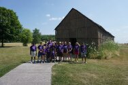Camp tribe in front of long house