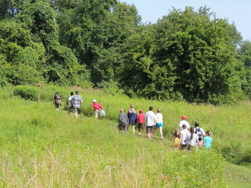 Campers hiking the trails at Mendon Ponds Park