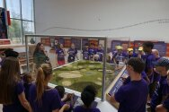Camp looking at model of Gonondogan Historical Site